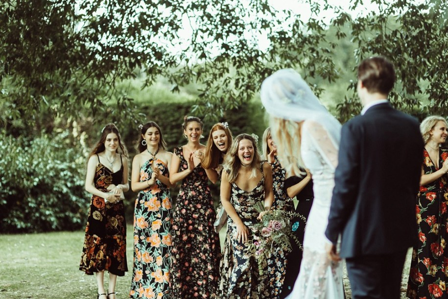 bridesmaids laughing during the outdoor wedding ceremony in New Forest
