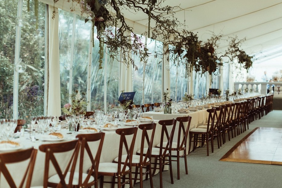 wedding reception table and decor in tent