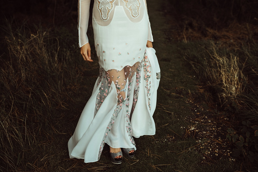 edgy bride wearing a custom made wedding dress in New Forest