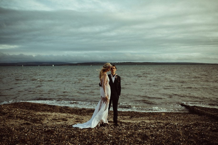 bride and groom portrait on the sea shore in New Forest, South West England