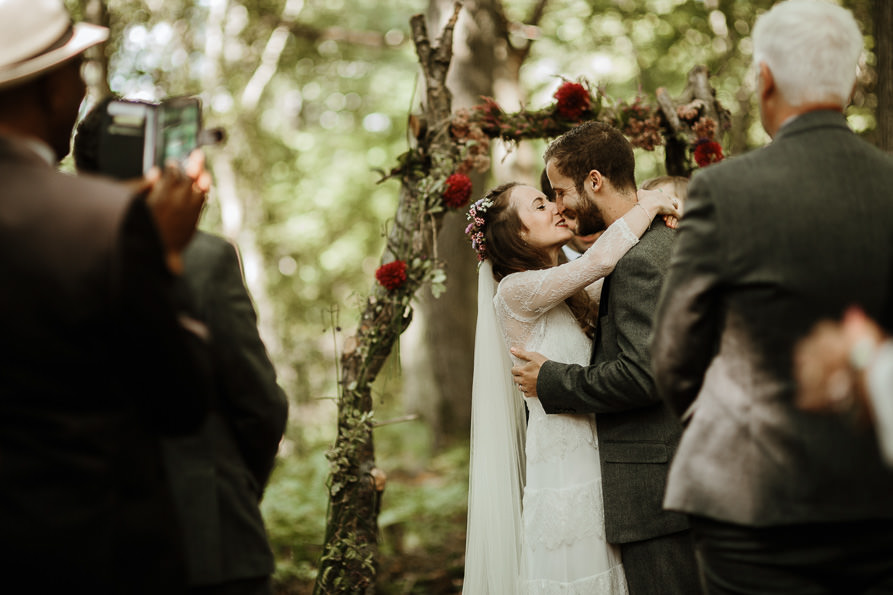 bride and groom first kiss for their outdoor wedding ceremony Surrey