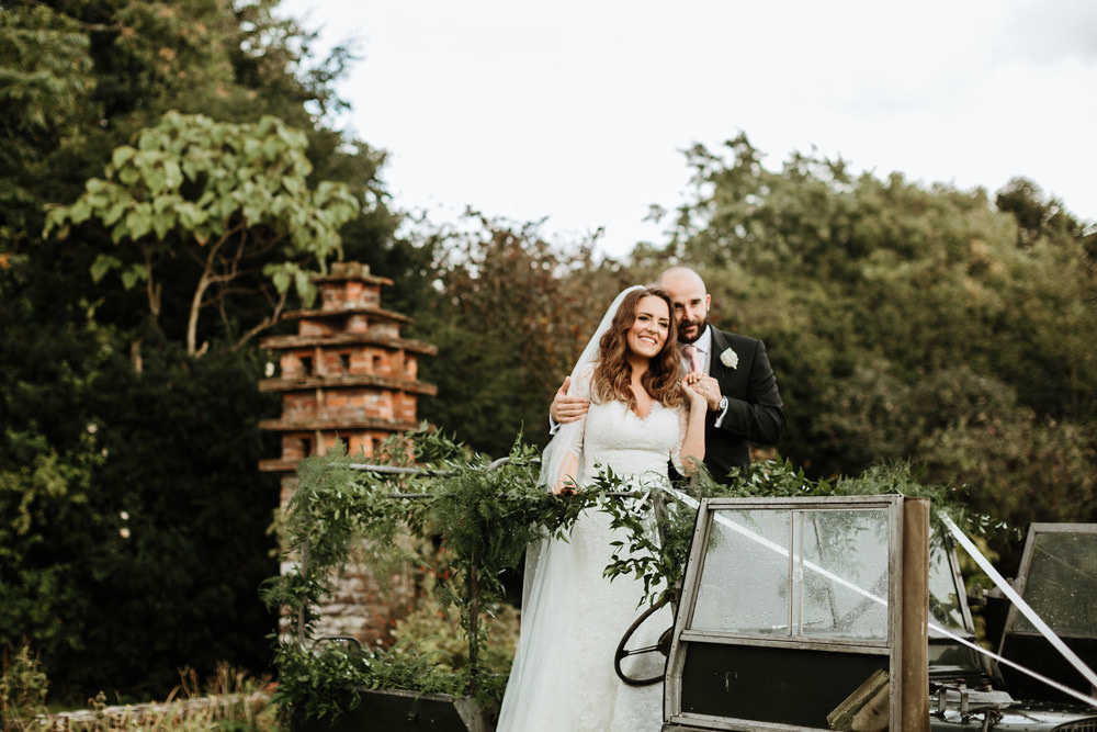 wedding portraits with vintage landrover with flowers for dorset wedding