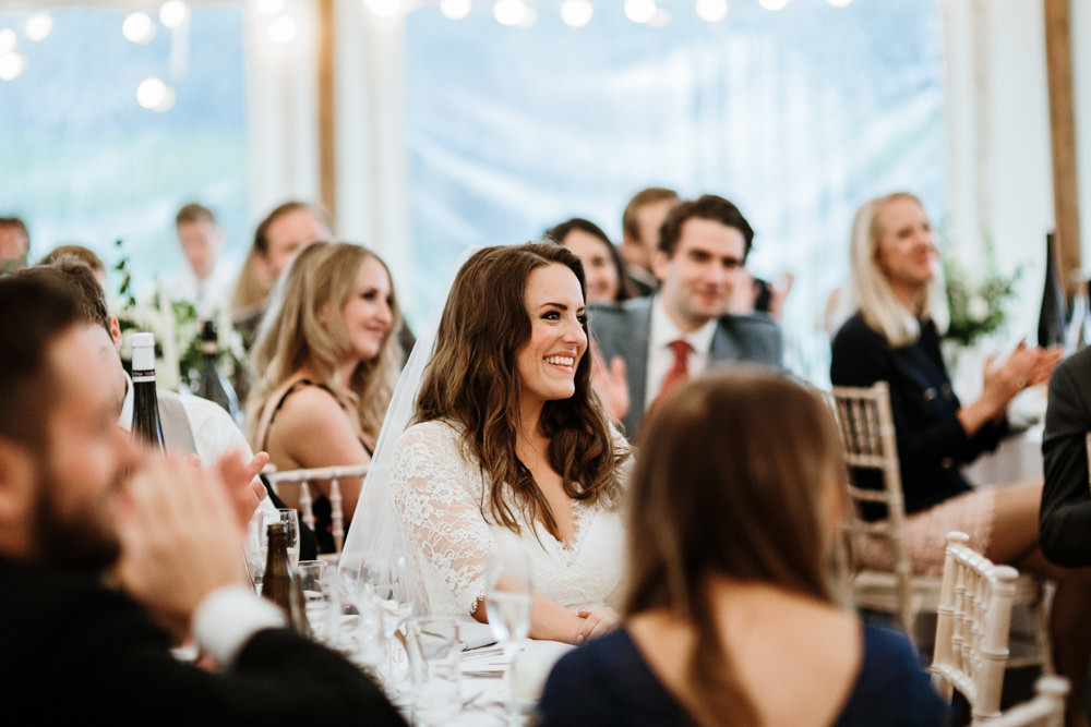 bride during speeches at marquee wedding on her private property
