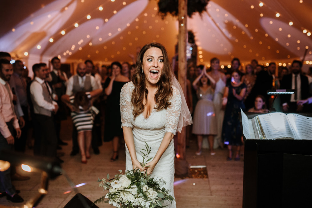 brides reaction to throwing her flowers in the air