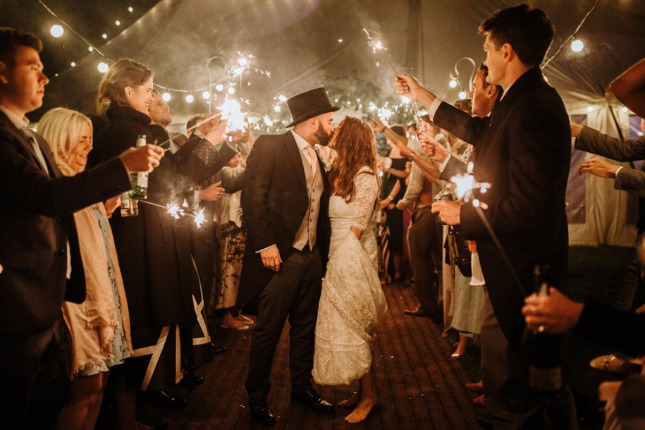 marquee wedding Somerset during sparklers exit