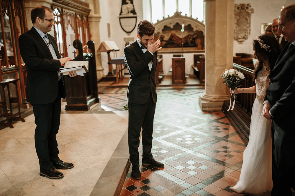 groom crying when he sees bride for first time