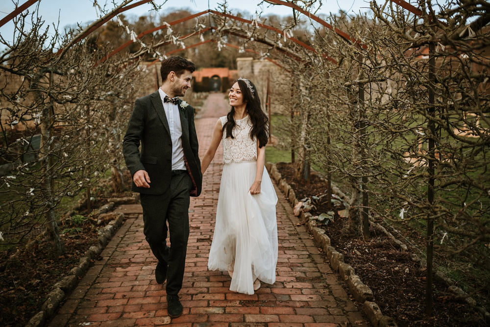 bride and groom walking in the gardens of the ethicurean restaurant Birstol