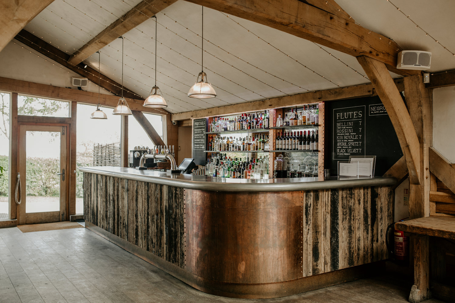 bar area with wood and copper at Cripps Barn Wedding Venue Cotswolds wedding photographer