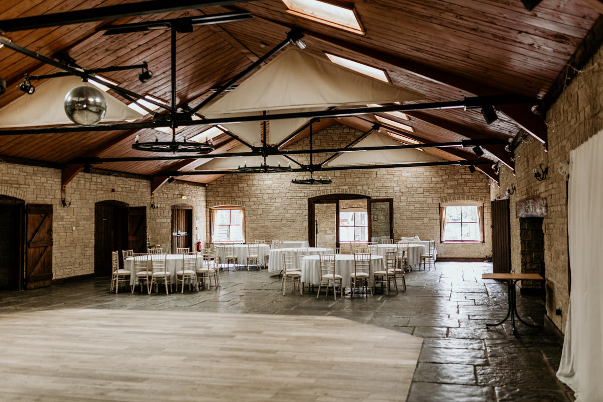 wedding reception arrangement and dance floor at The Barn at Berkeley Wedding Venue Cotswolds   Green Antlers Photography
