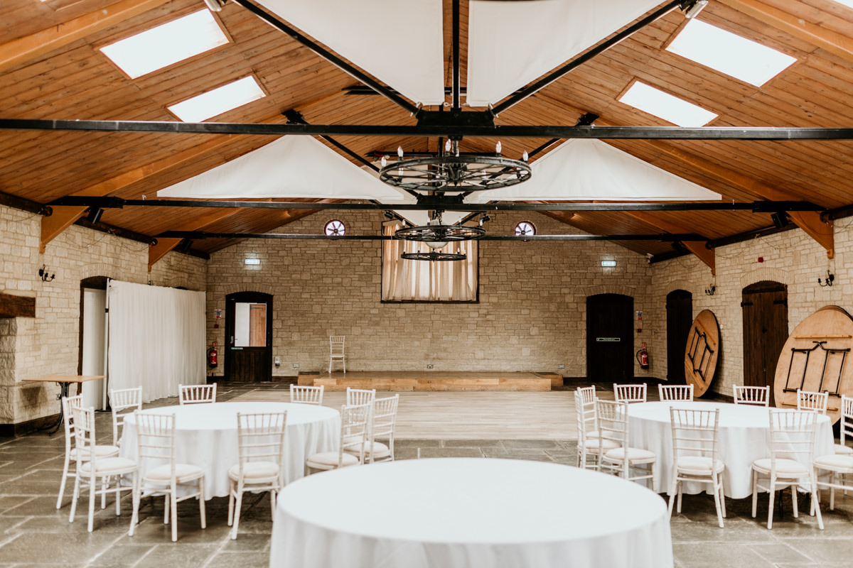 wedding reception at The Barn at Berkeley Wedding Venue Cotswolds   Green Antlers Photography