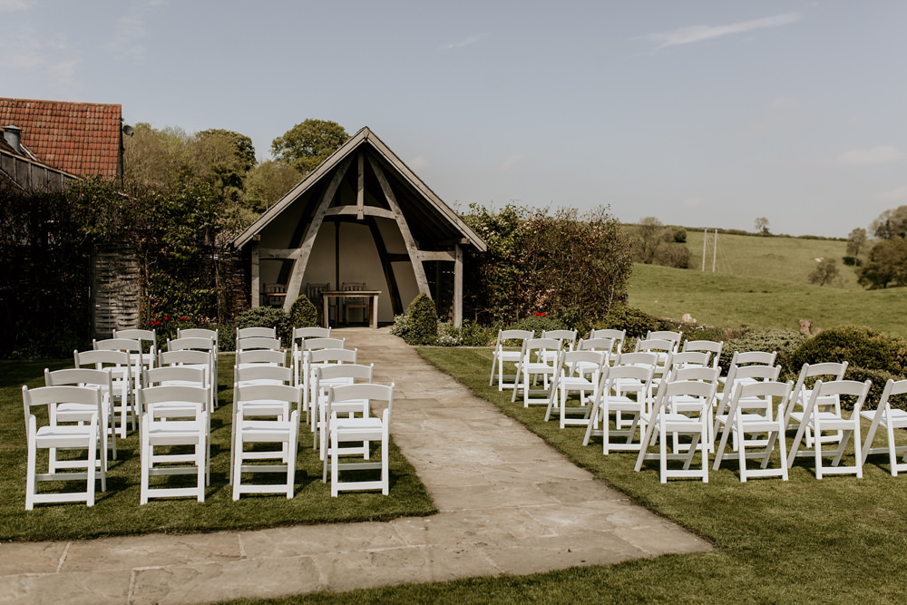 outdoor wedding ceremony area at The Kingscote Barn Wedding venue