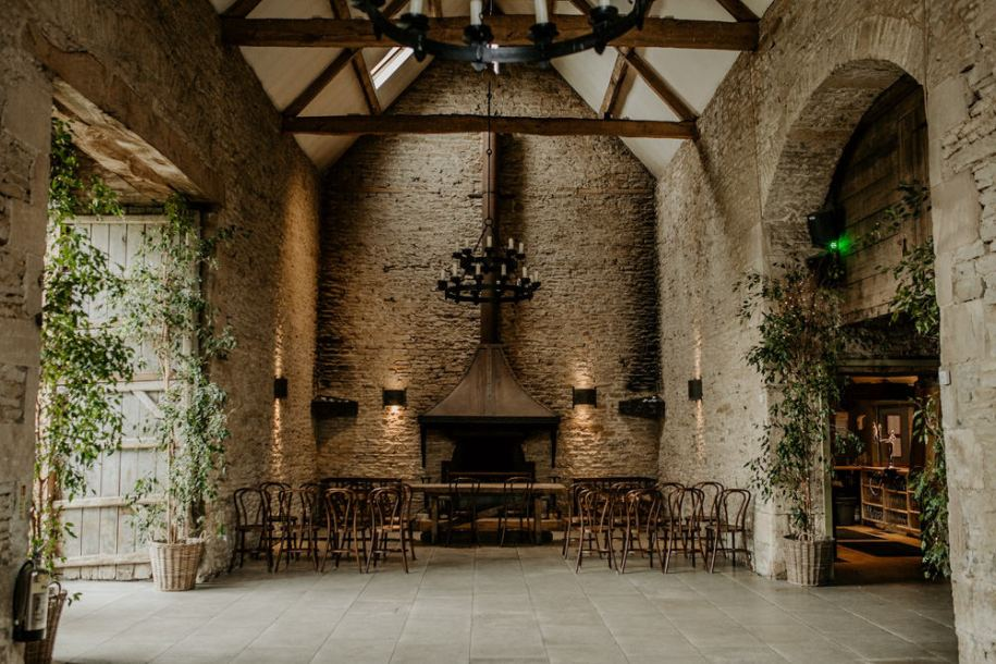 indoor wedding ceremony area at Stone Barn Wedding Venue Cotswolds
