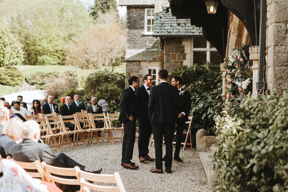groomsmen and groom waiting for bride by the altar for their outdoor wedding ceremony at Plas Dinam Country House