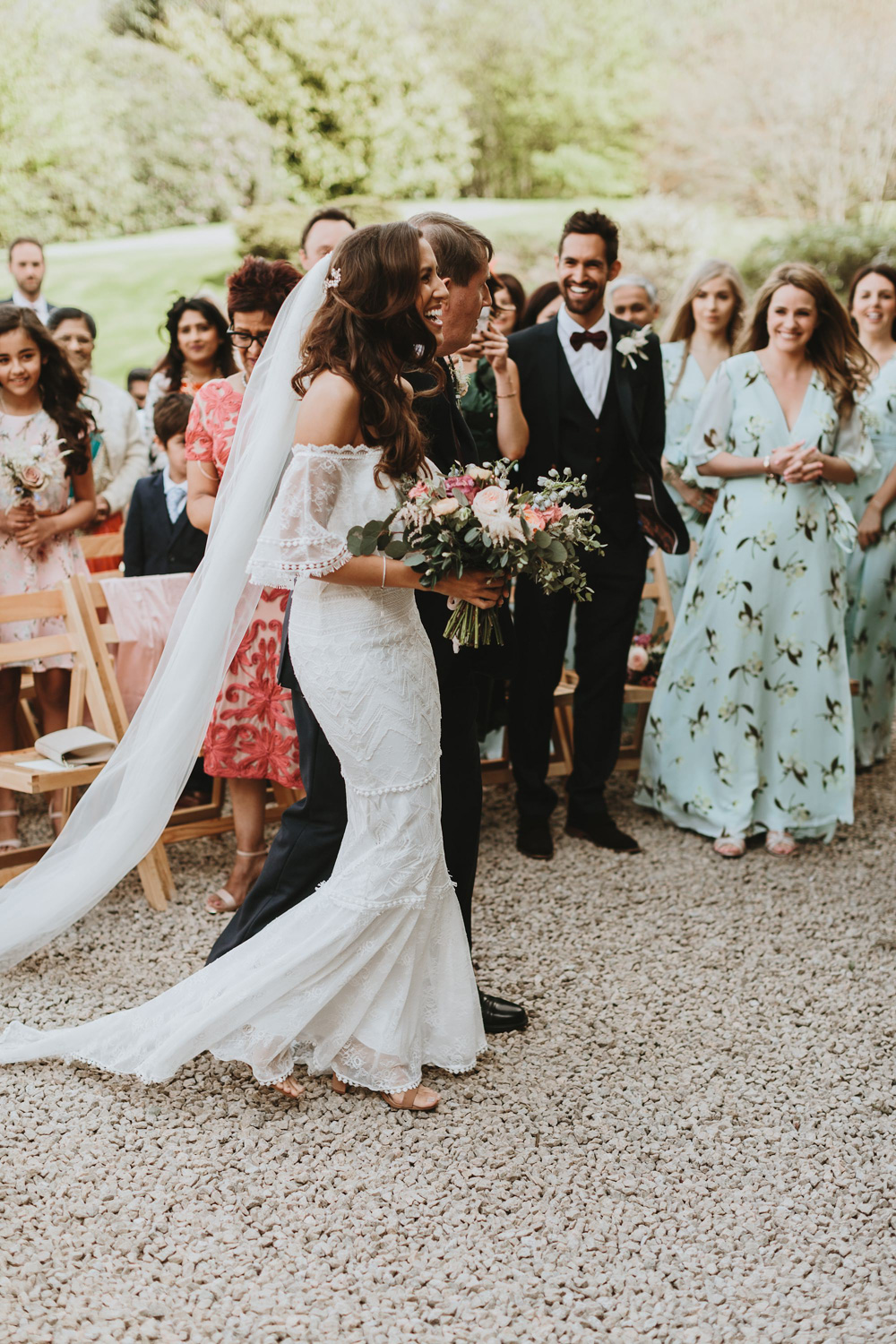 bride and father walk down the aisle at plas dinam country house