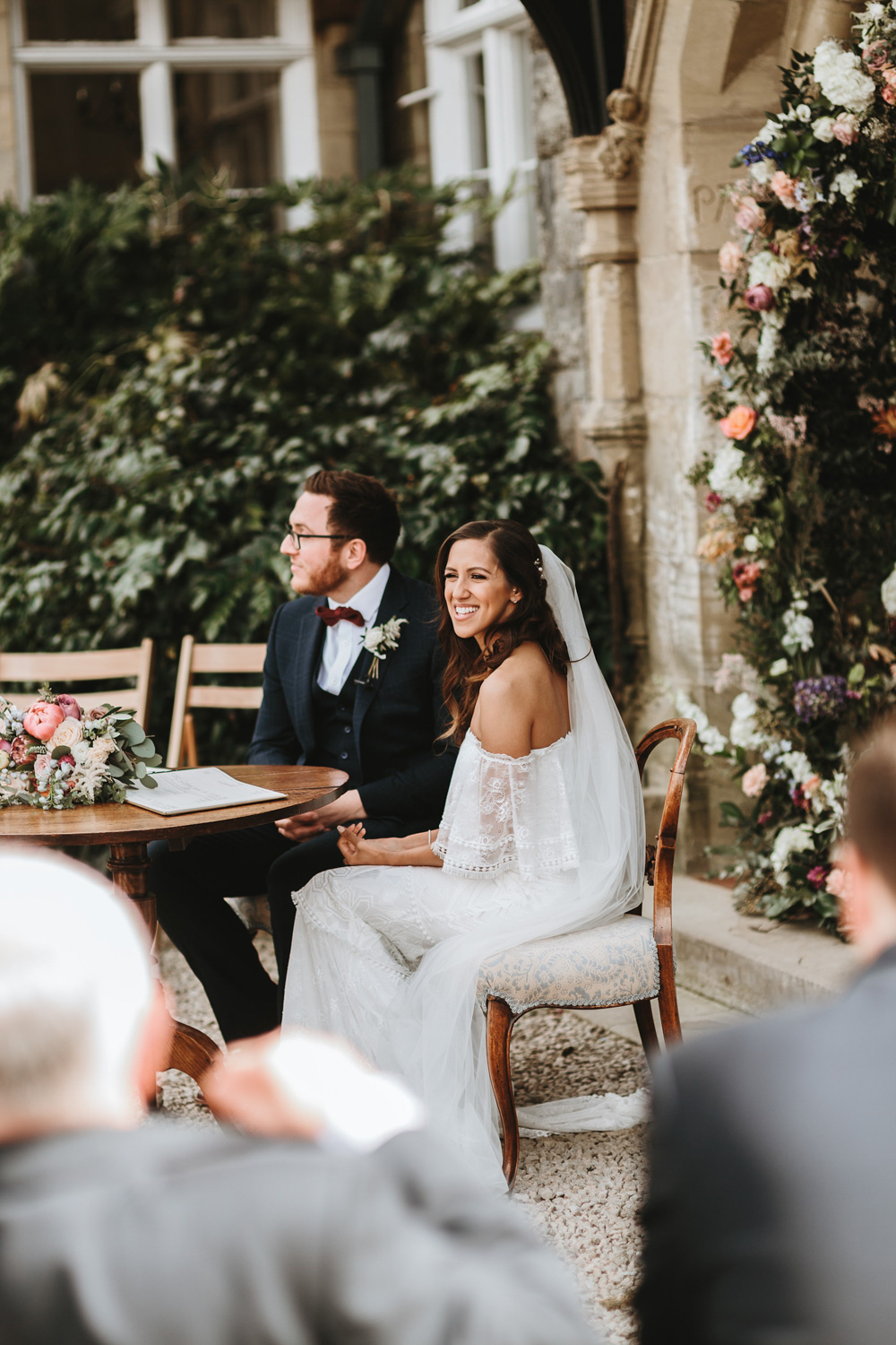 bride and groom in Wales during their outdoor wedding ceremony at plas dinam country house