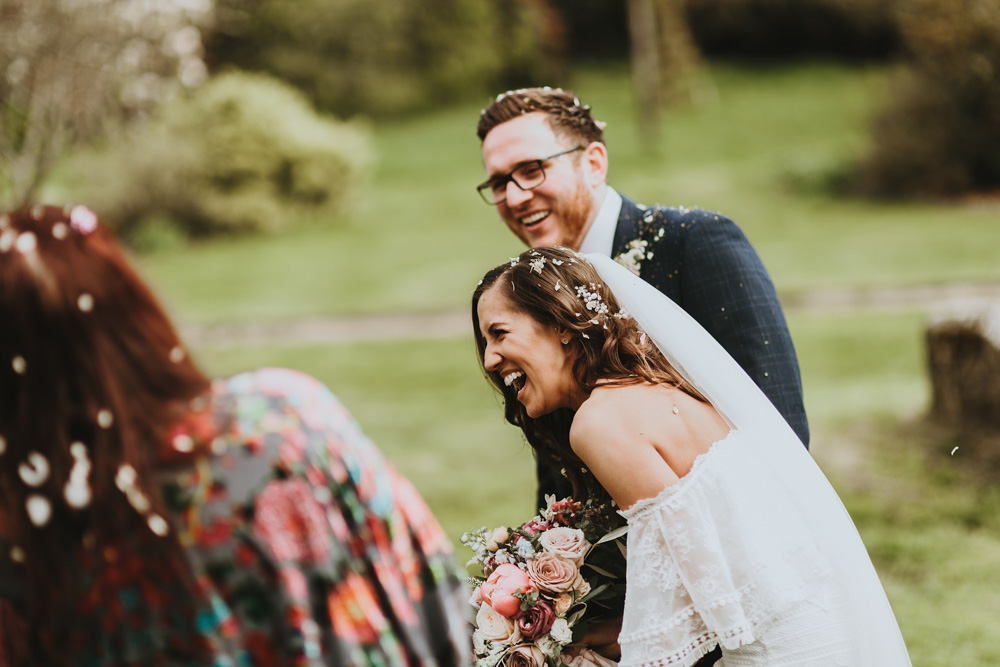 bride and groom after the confetti during their wedding at plas dinam country house