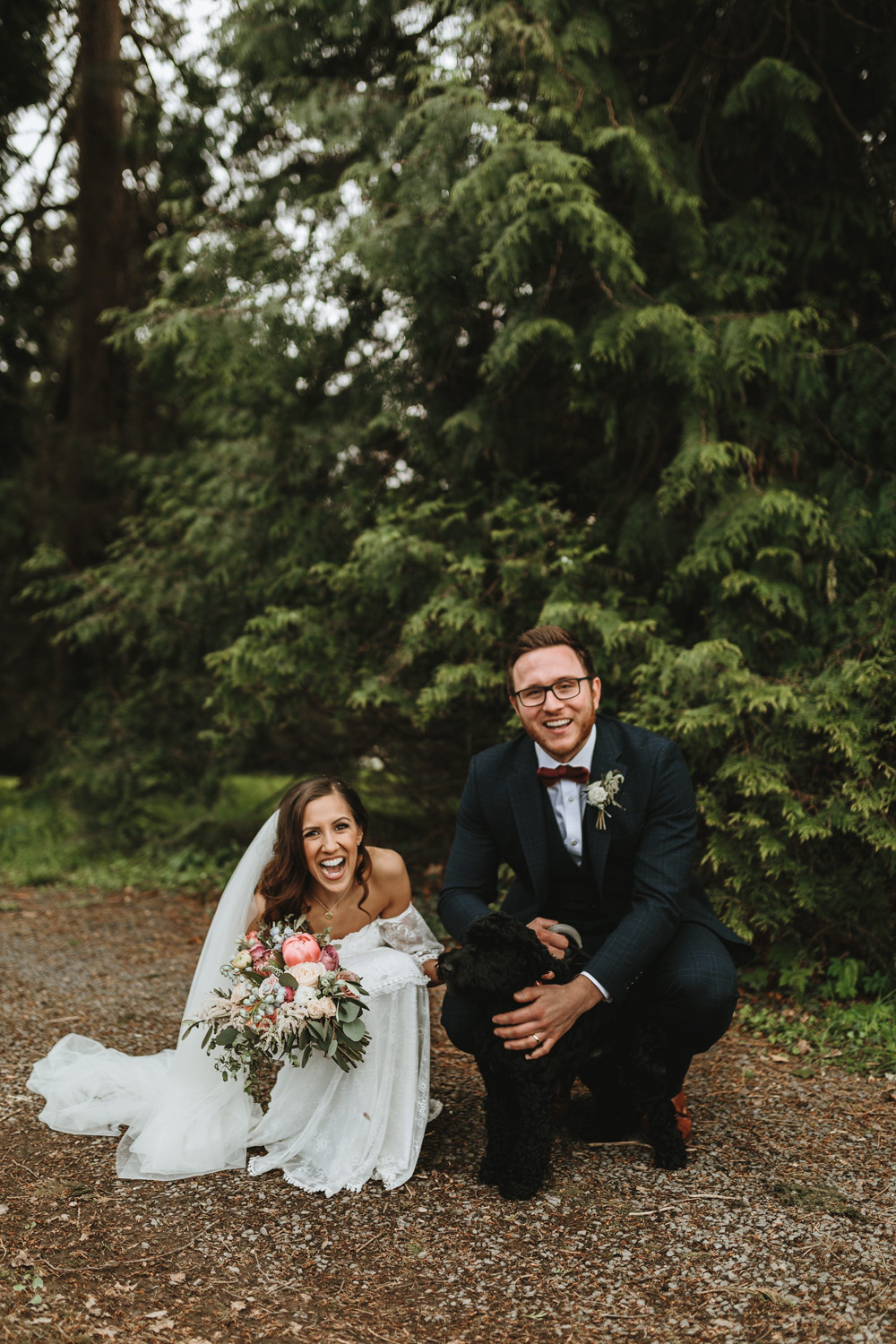 bride and groom with dog during their plas dinam country house wedding