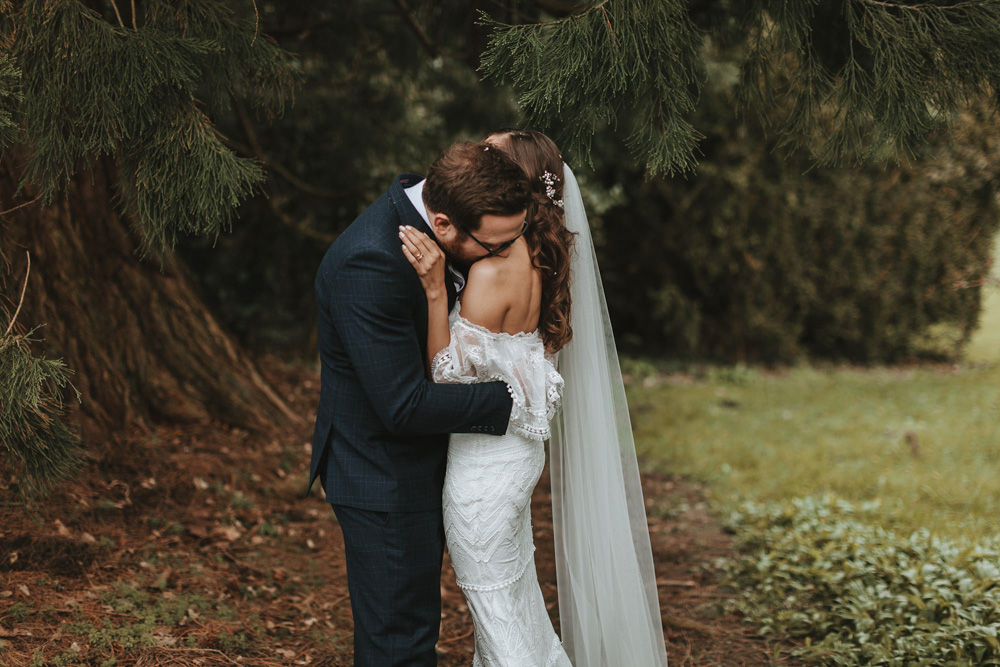 intimate shot of bride and groom at plas dinam country house by Wales wedding Photographer