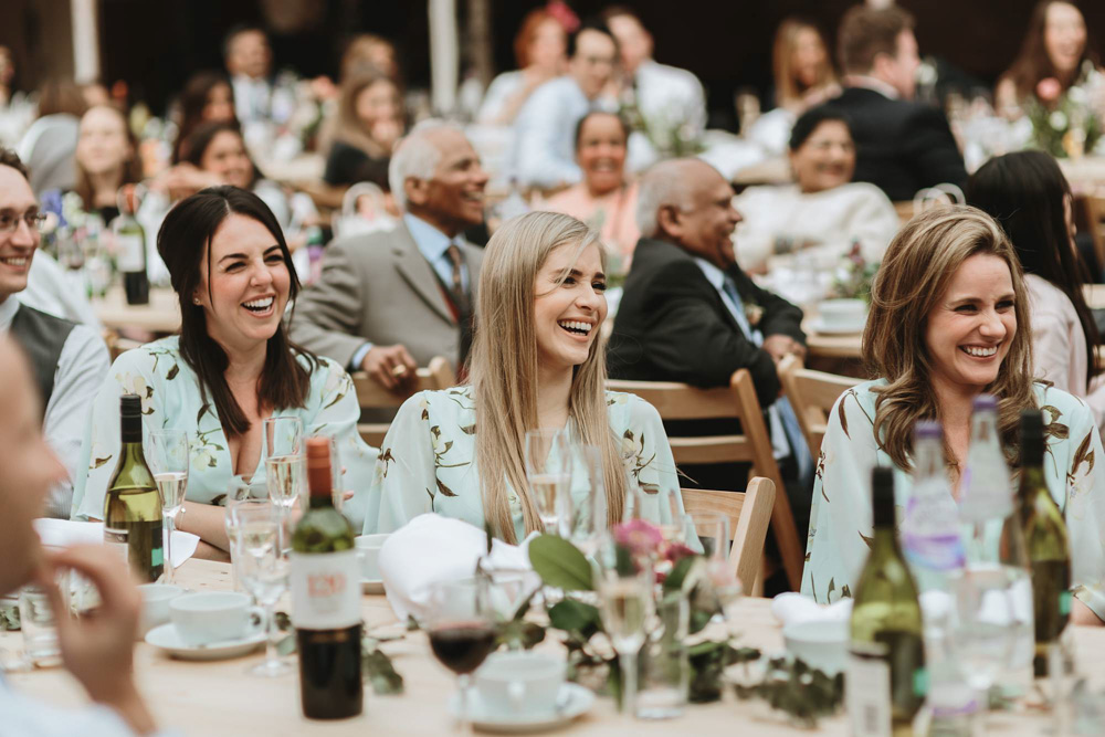 bridesmaids laughing during speeches at plas dinam country house wedding reception