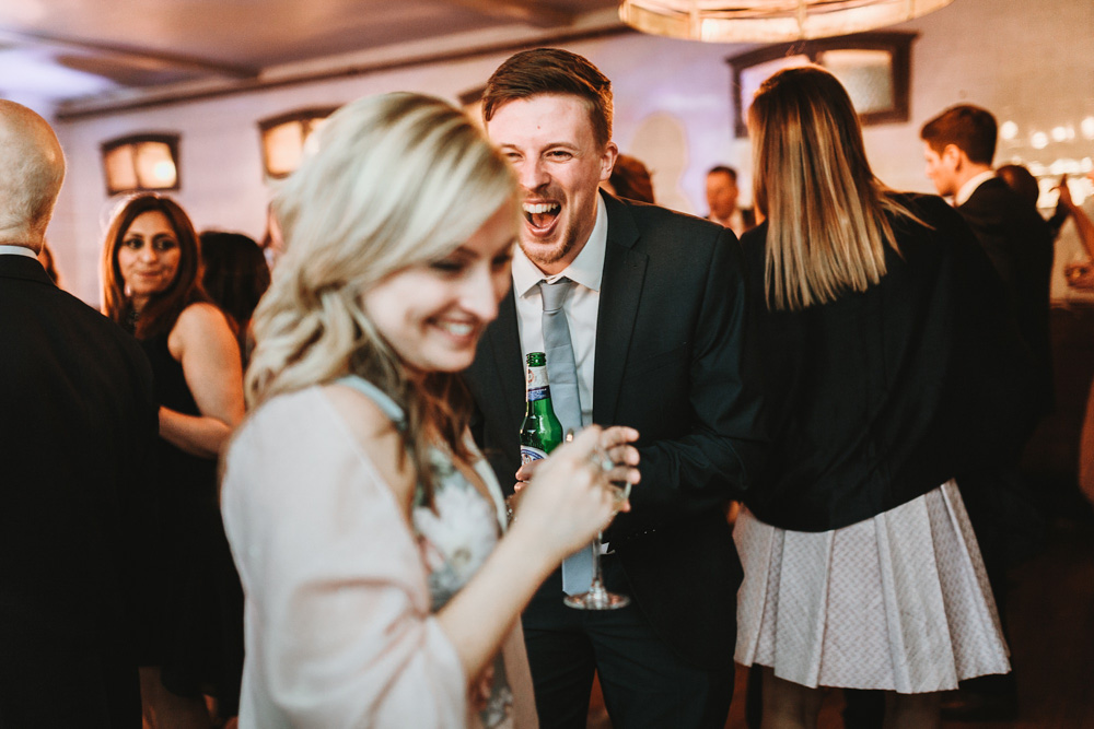 guests laughing and dance at plas dinam country house wedding reception Wales