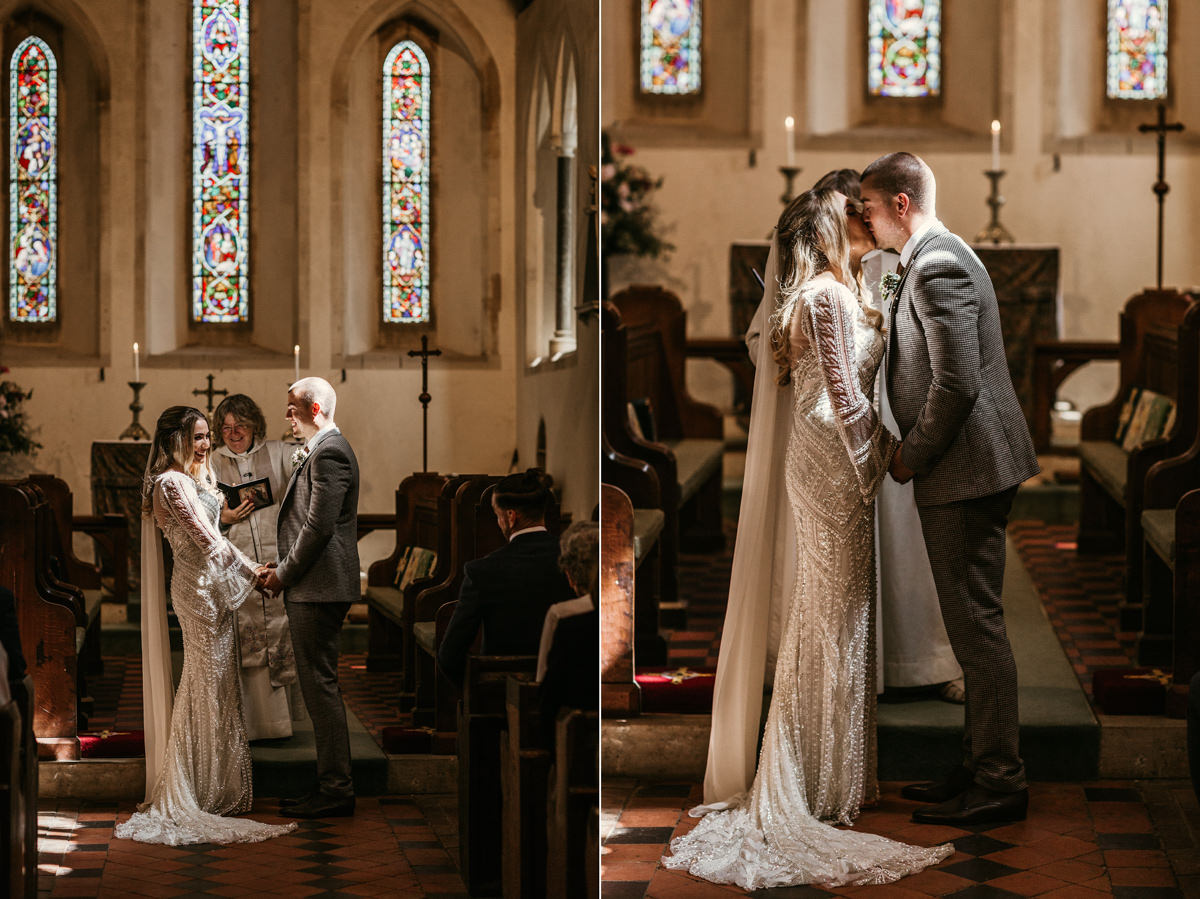 bride and groom first kiss during church wedding ceremony by Canterbury wedding photographers