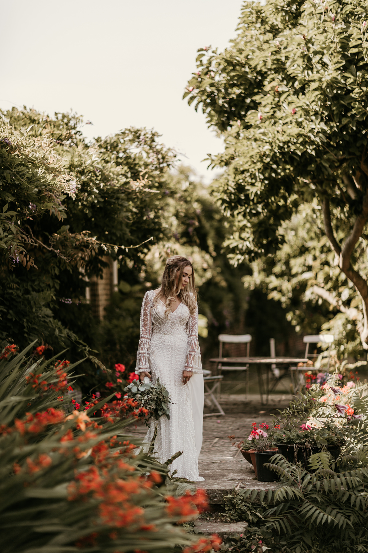 bride wearing a Justin Alexander wedding dress during the portrait session by Green antlers Photography, preston court wedding venue by Canterbury wedding photographers