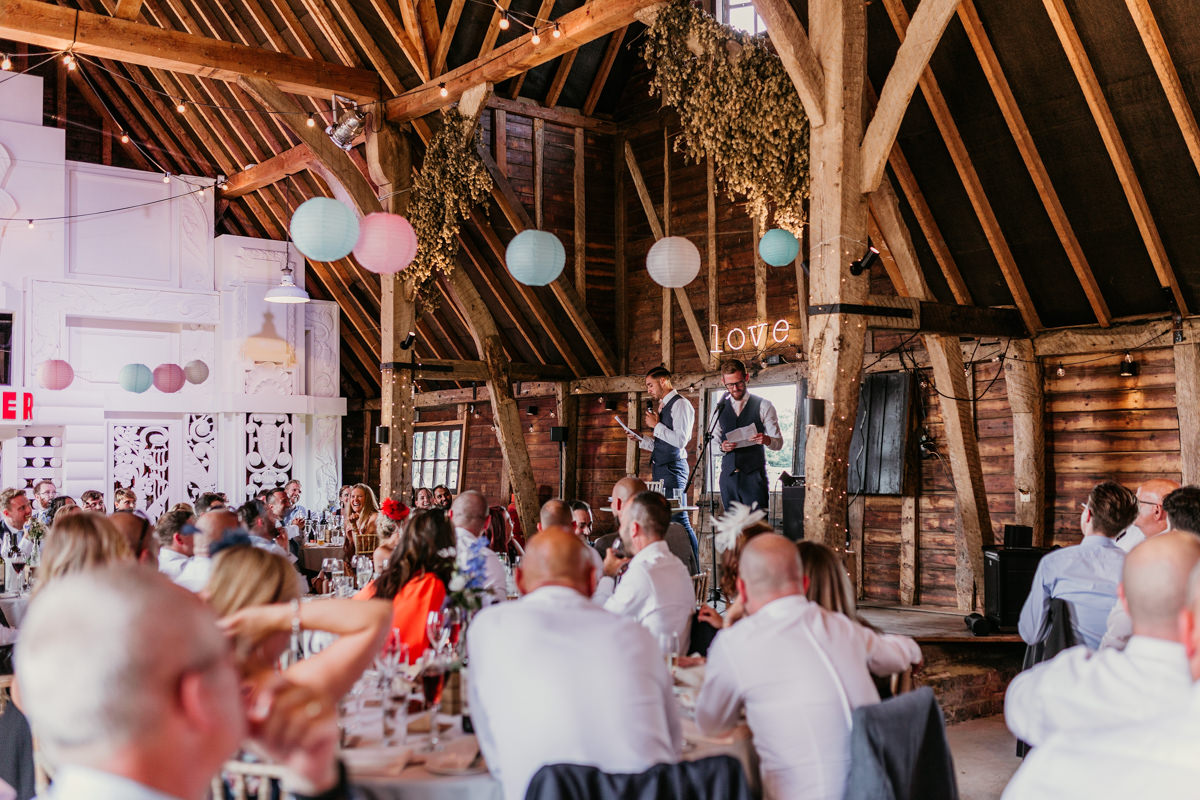 wedding reception in a wooden barn at preston court wedding venue by Canterbury wedding photographers