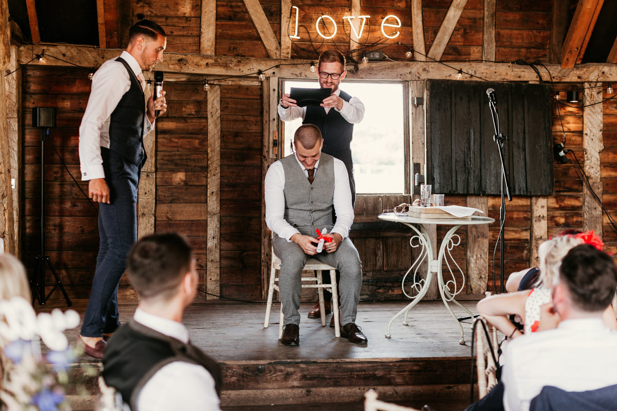 funny wedding speech during the reception at preston court wedding venue by Canterbury wedding photographers