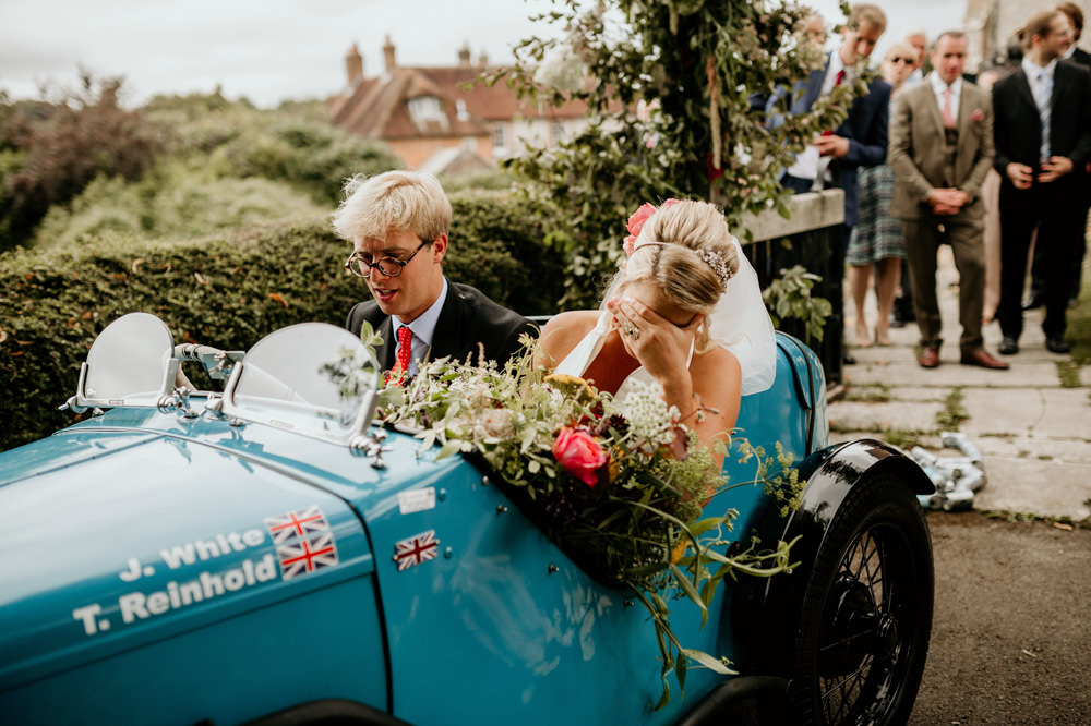 blue Austin 7 Ulster vintage car for their wedding getaway car