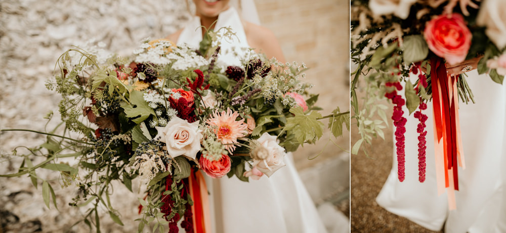 huge wedding flowers bouquet with bride wearing a JEsus Peiro wedding dress at The Kennels Goodwood wedding venue England