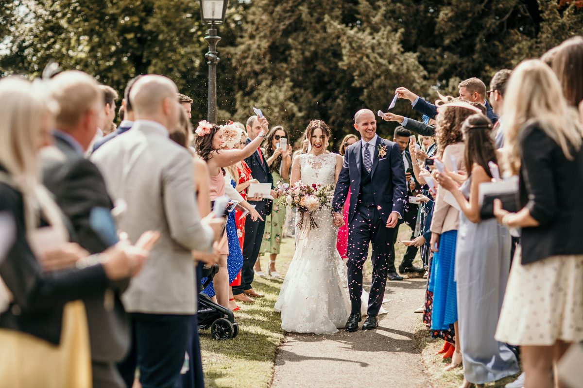 confetti shot during the wedding ceremony at Merriscourt Barn Wedding venue by Cotswolds wedding photographer
