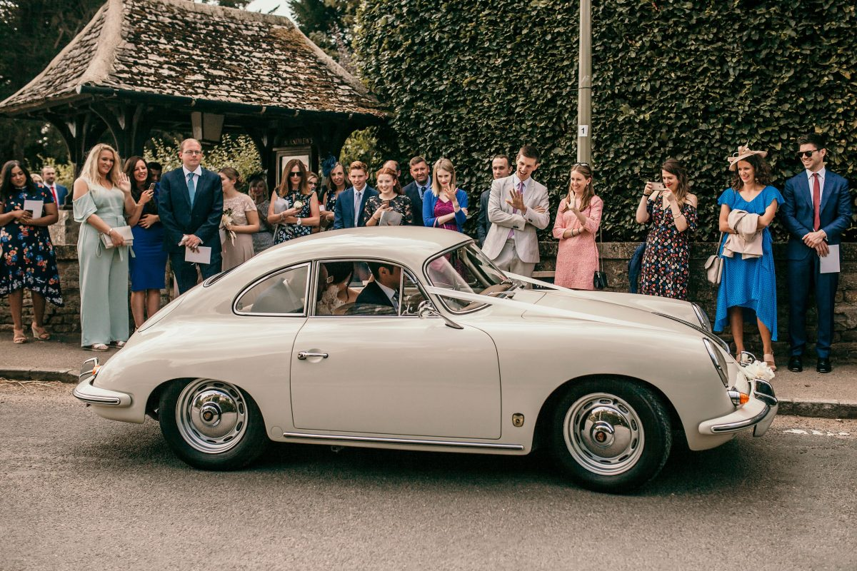 bride and groom in vintage wedding car at Merriscourt Barn Wedding venue by Cotswolds wedding photographer