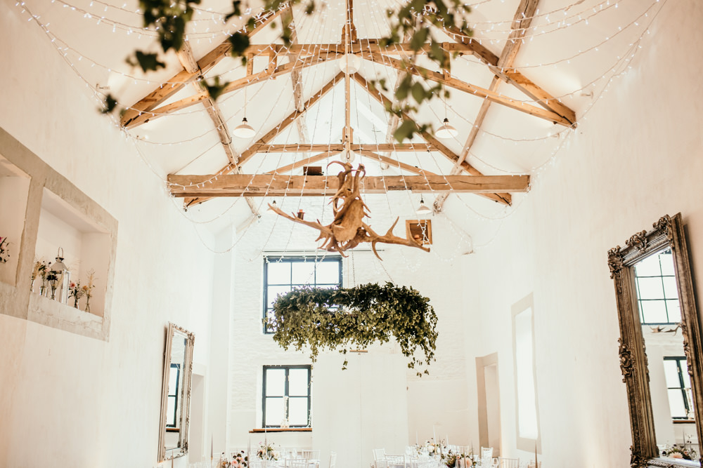 foliage chandelier in the White Barn for Merriscourt Barn wedding in Chipping Norton by wedding photographers Cotswolds