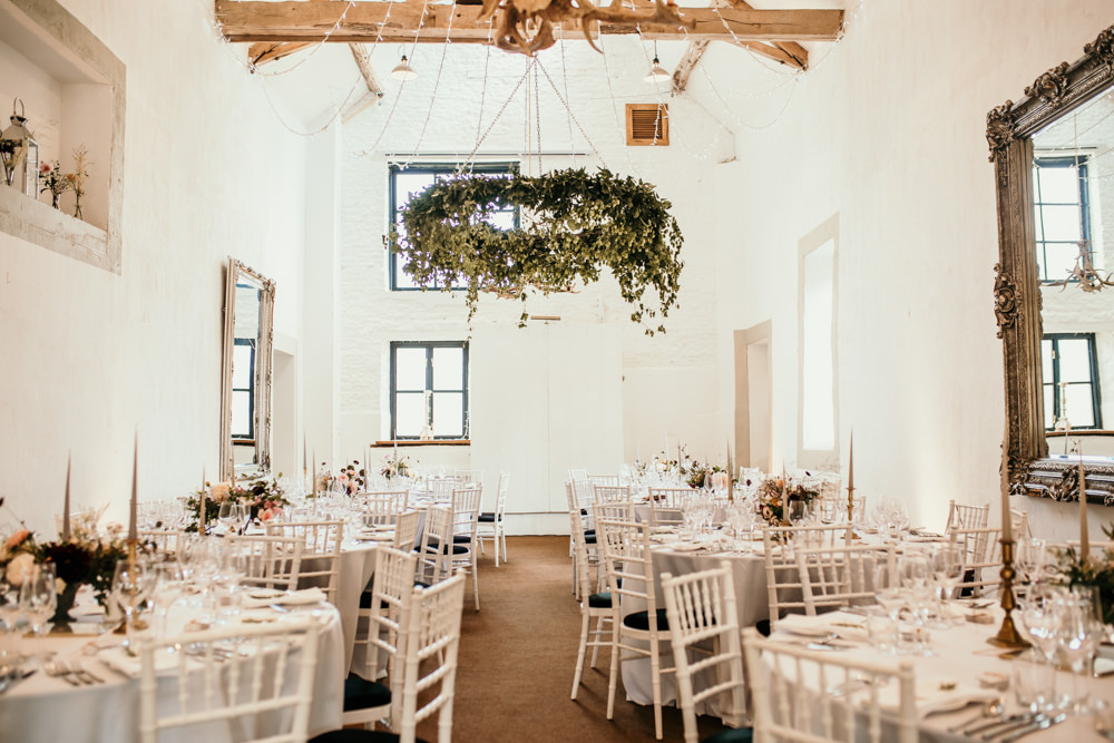 barn arrangement and round tables for wedding at Merriscourt Barn by Cotswolds wedding photographers Green Antlers Photography
