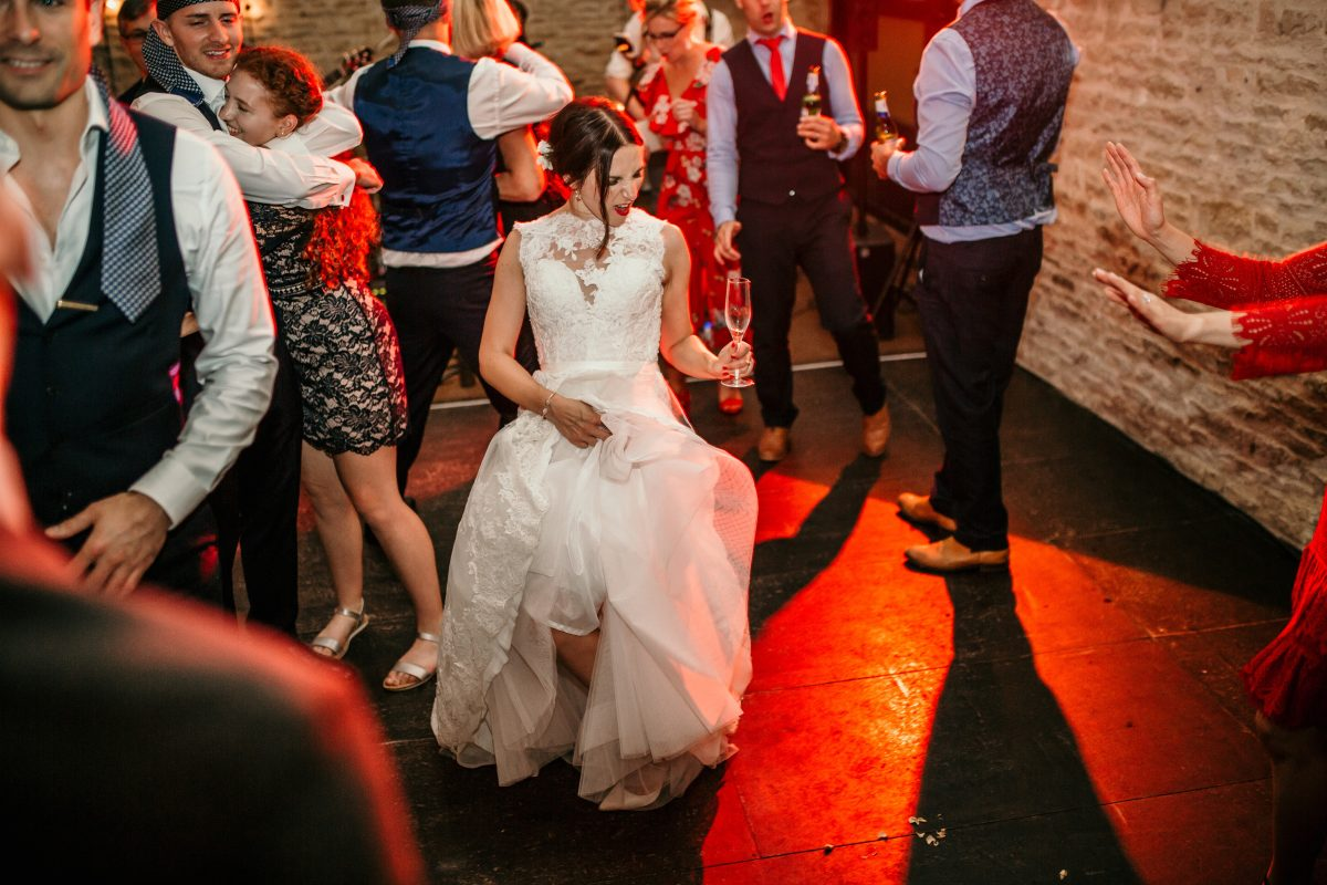 bride on the dance floor at Merriscourt Barn Wedding venue by Cotswolds wedding photographer