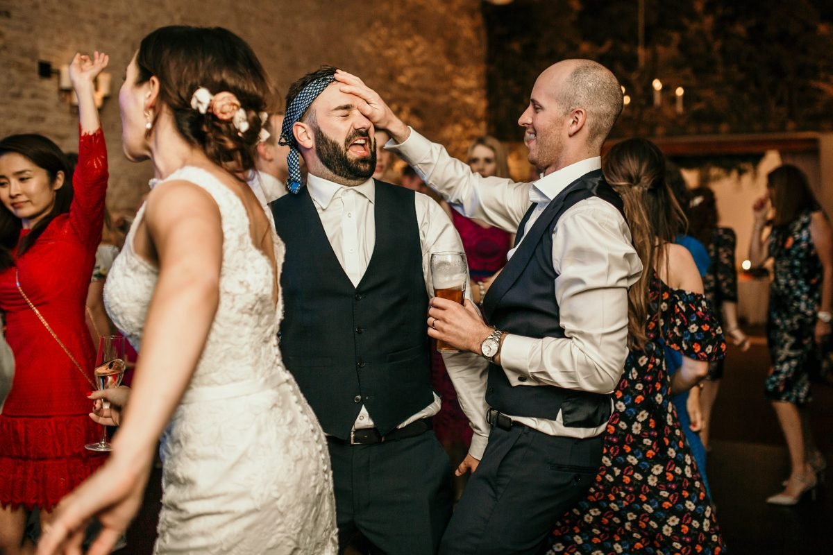 fun wedding party at Merriscourt Barn Wedding venue by Cotswolds wedding photographer