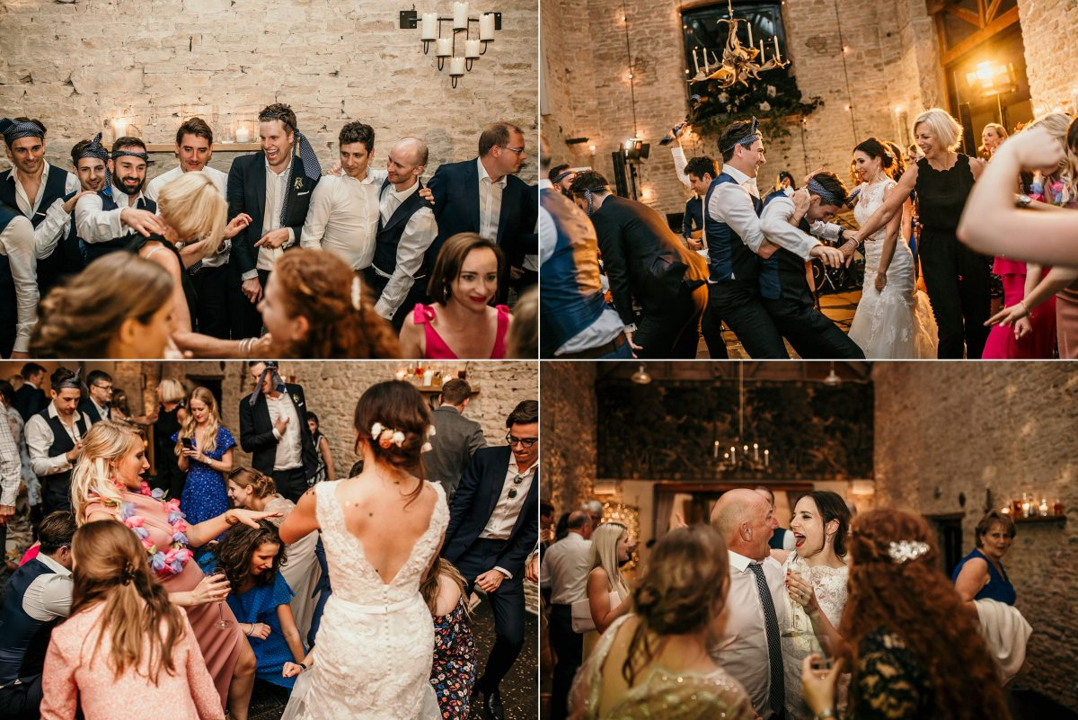 guests dancing on the dance floor during the wedding party at Merriscourt Barn Wedding venue by Cotswolds wedding photographer