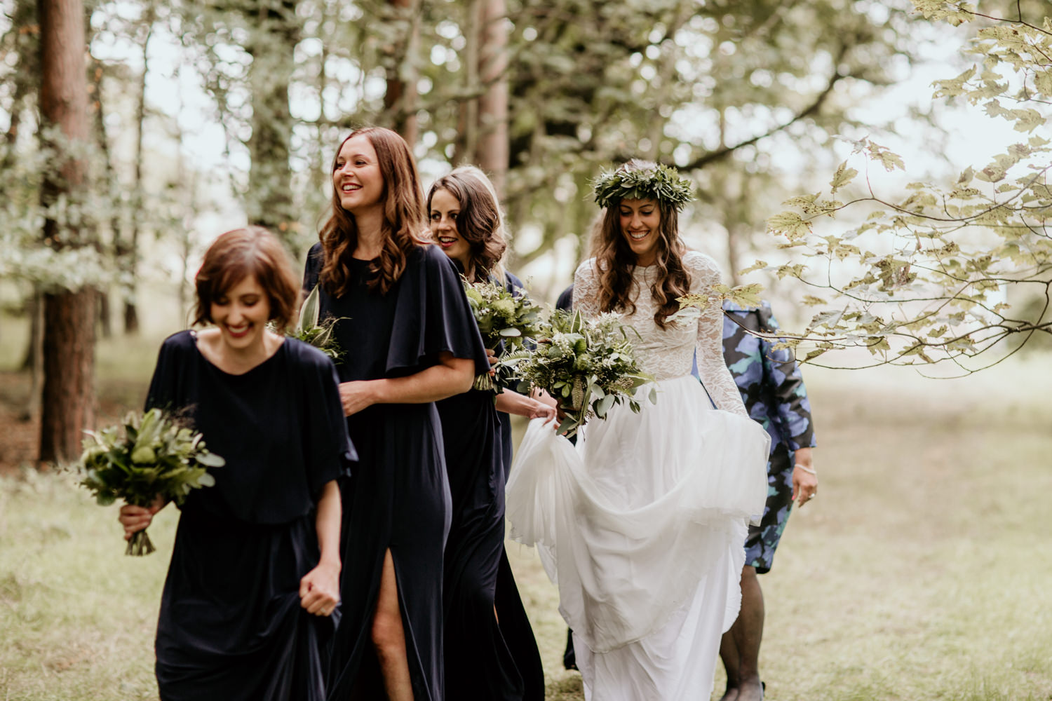 bride walking with bridesmaids before the outdoor wedding ceremony at Harvest Moon Holidays Scotland