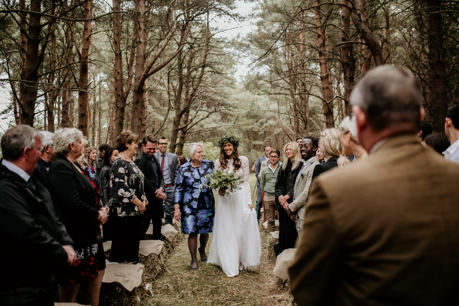 bride and mother walking down the aisle during the outdoor wedding ceremony at Harvest Moon Holidays Scotland