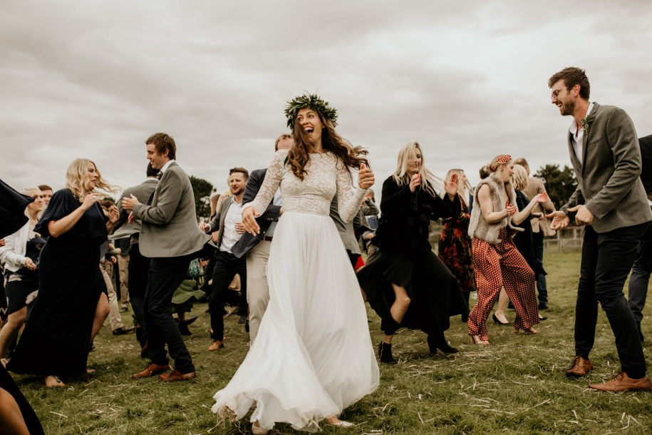 bride dancing with friends during a flash mob at her Harvest Moon Holidays Scotland wedding