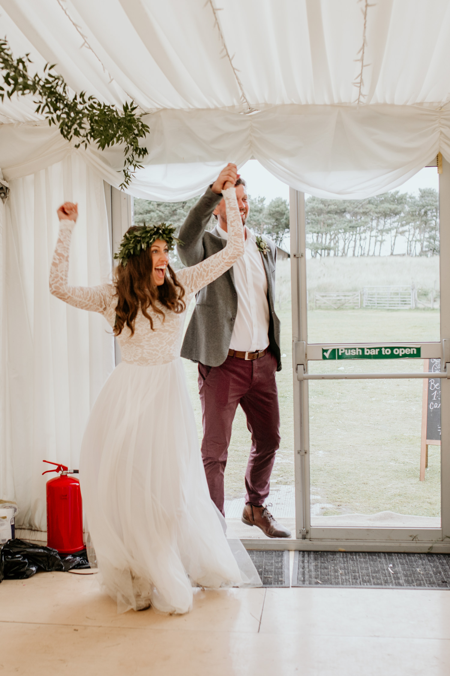bride and groom entering the marquee for their Harvest Moon Holidays wedding in Scotland