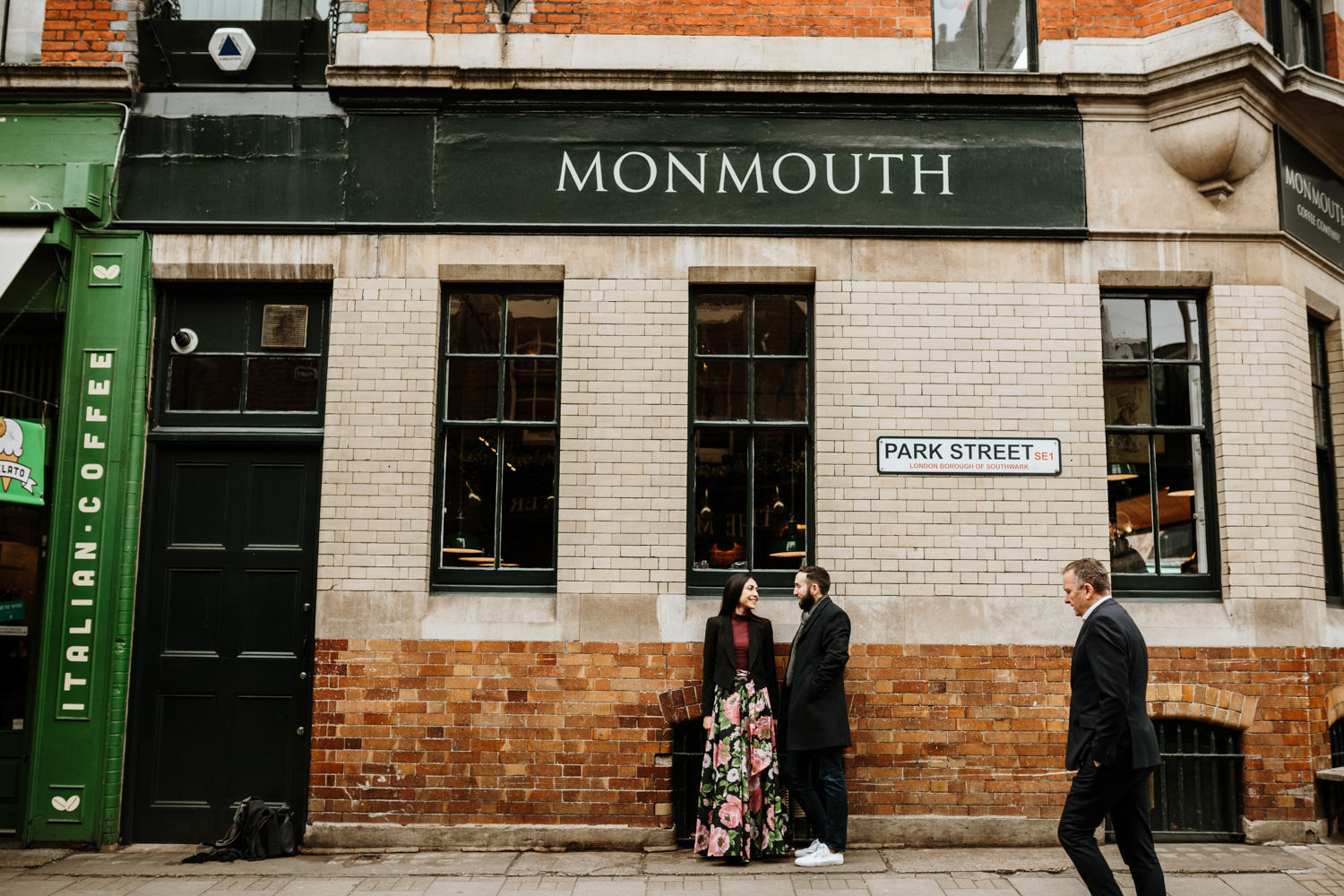 couple in London near Monmouth cafe during the Winter