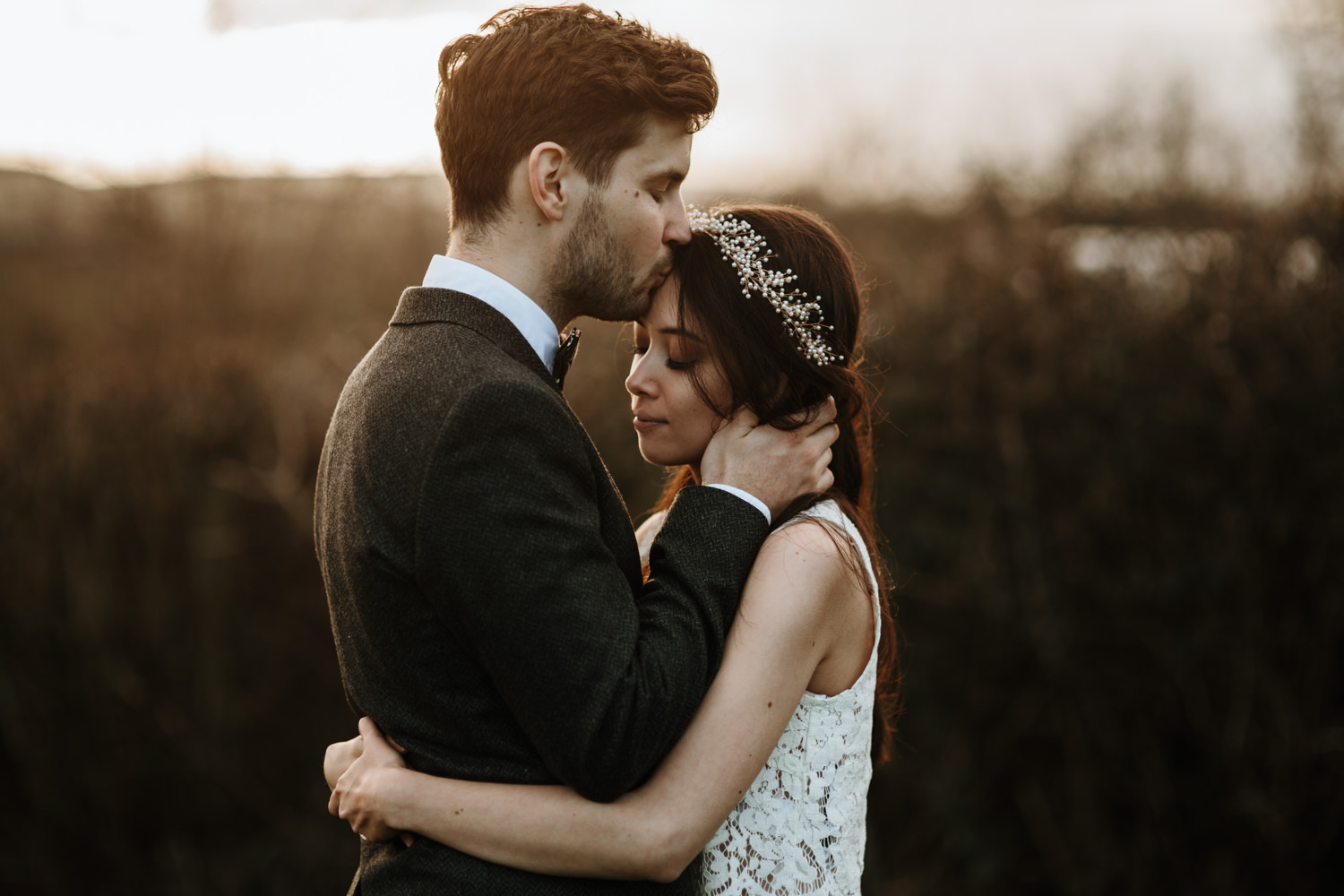 wedding couple kissing on the forehead during their portraits by Bristol Wedding photographers