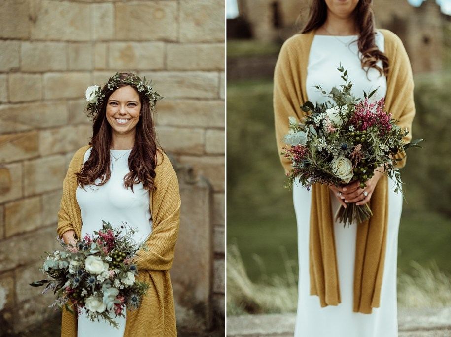 bride wearing a mustard scarf with her bohemian wedding bouquets in Scotland