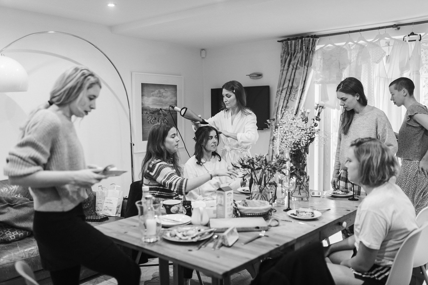 black and white image of bride and bridesmaids getting ready for their Stroud wedding Cotswolds