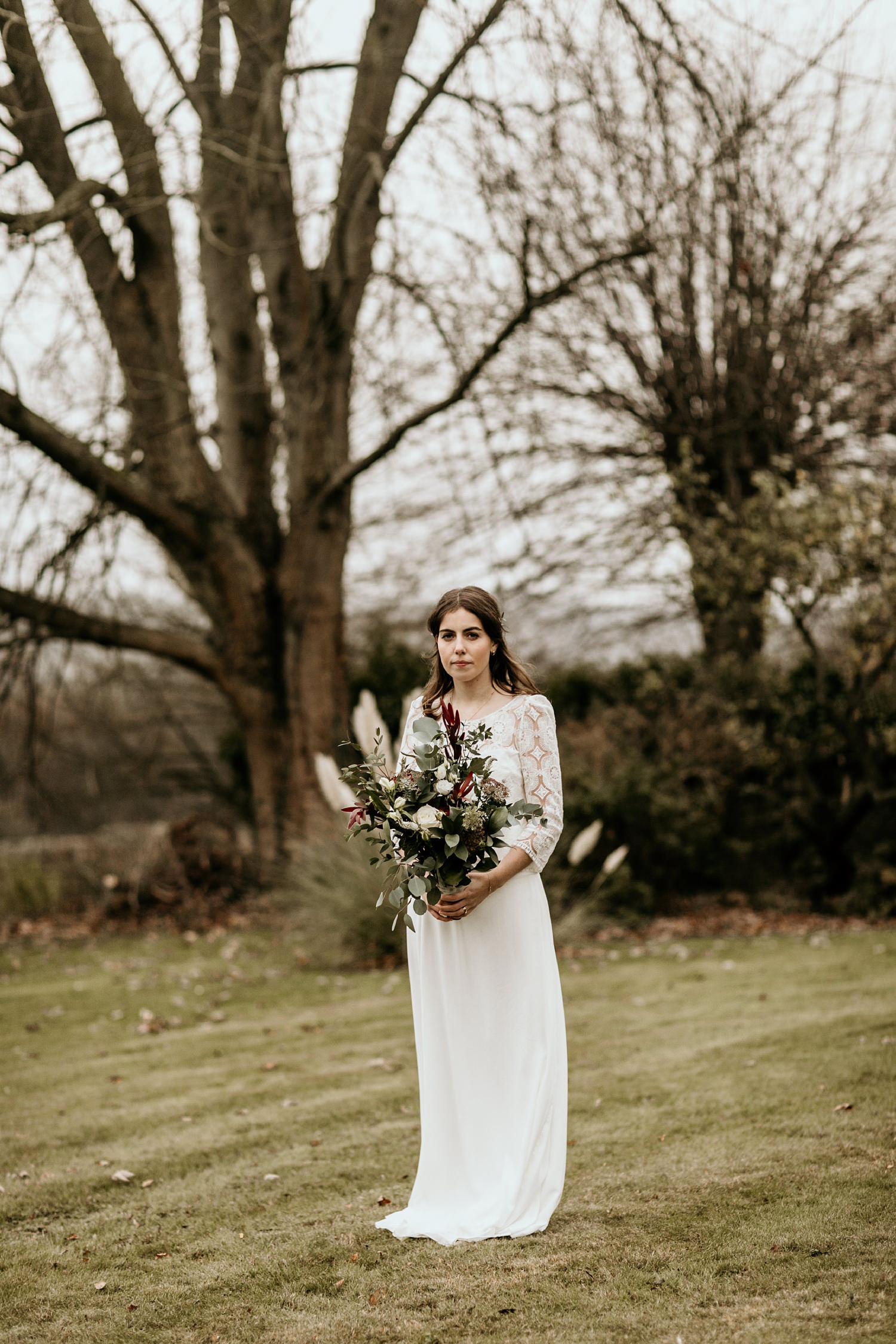 boho bridal portrait during a Winter wedding in Stroud by Cotswolds wedding photographers