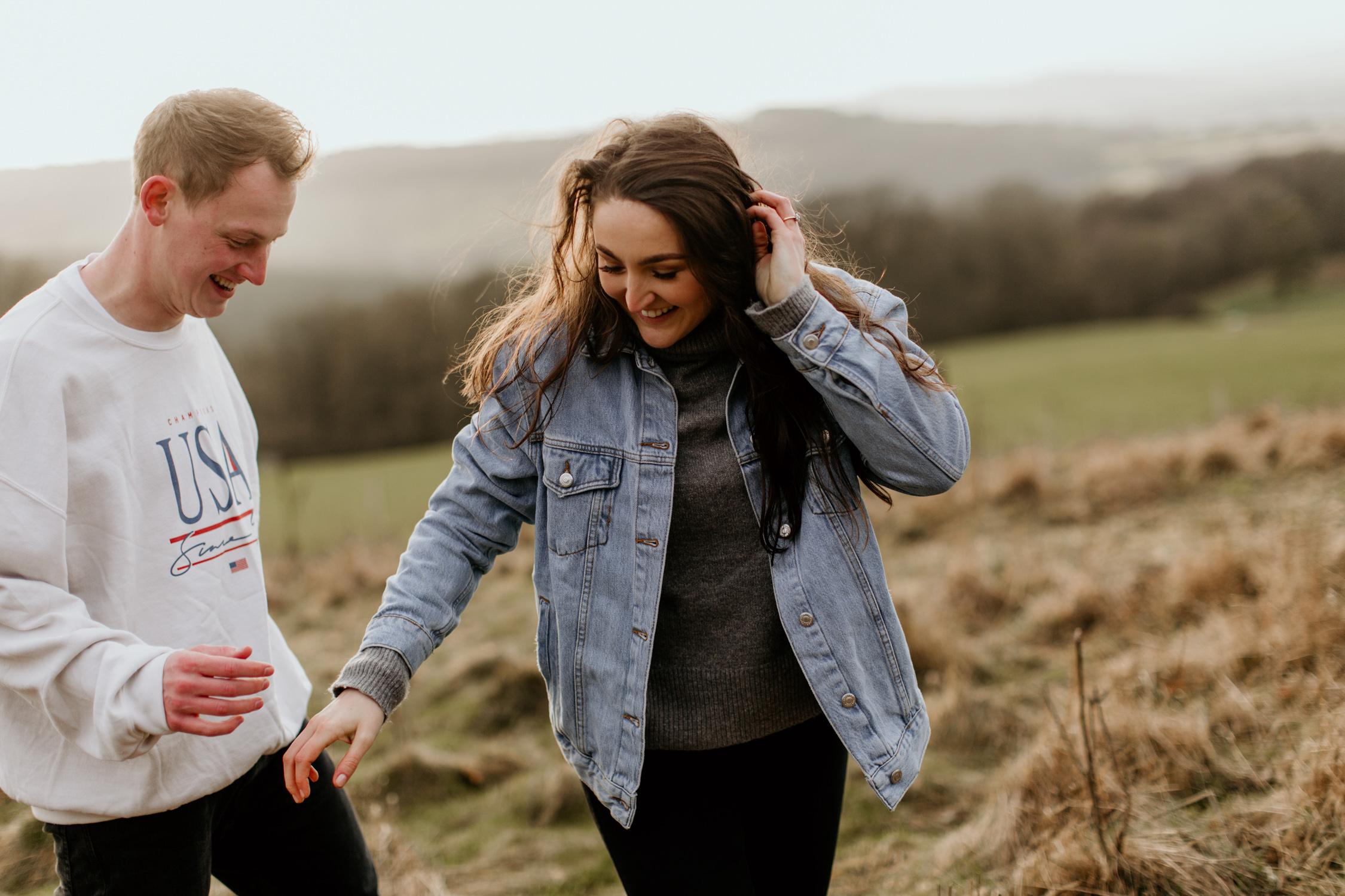 girl walking during her engagement session in the Cotswolds countryside