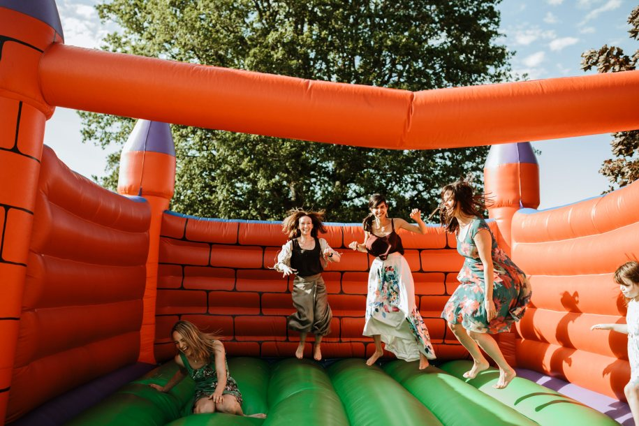 bouncy castle for an outdoor wedding cocktail hour game