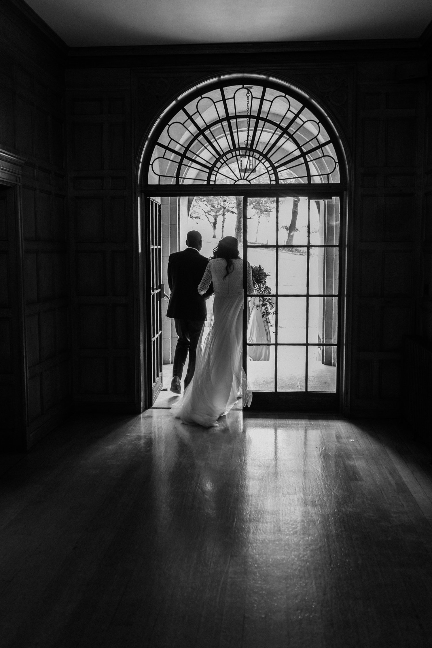 bride and dad walking out towards the outdoor wedding ceremony at Coombe Lodge Blagdon wedding venue