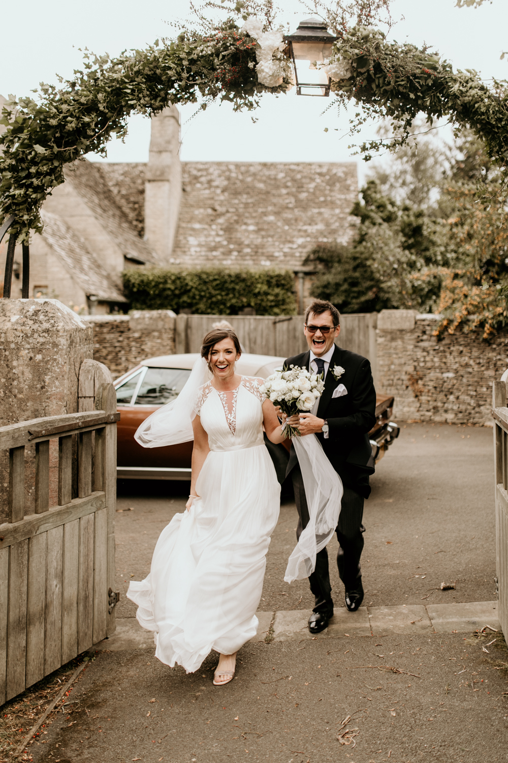 bride and dad arrive at church for her wedding ceremony